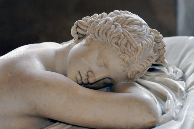 Detail of head. Greek marble, 2nd century A.D. Roman copy after a Hellenistic original of the 2nd century B.C. Restored in 1619 by David Larique. Mattress made of Carrara marble by Gianlorenzo Bernini in 1619 on Cardinal Borghese's request. L. 1.69 m (5 ft. 6 1/2 in.), W. 89 cm (35 in.)  Louvre Museum, Paris< France. Accession number Ma 231 (MR 220). --- Image by © Corbis